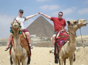 Couple riding camels